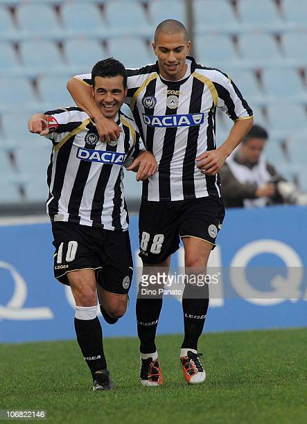 Antonio Di Natale of Udinese celebrates with teammate Gokhan Inler after scoring the opening goal during the Serie A match between Udinese and Lecce...
