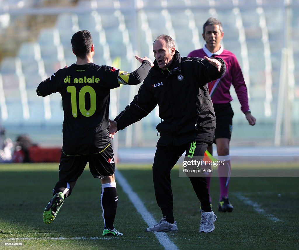 Antonio Di Natale (L) of Udinese celebrates with their head coach Francesco Guidolin (R) after scoring the opening goal during the Serie A match between Pescara and Udinese Calcio at Adriatico Stadium on March 3, 2013 in Pescara, Italy.