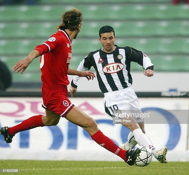 Antonio Di Natale of Udinese competes with Roberto Maltagliati of Cagliari during the Serie A match between Udinese and Cagliari at the Friuli...