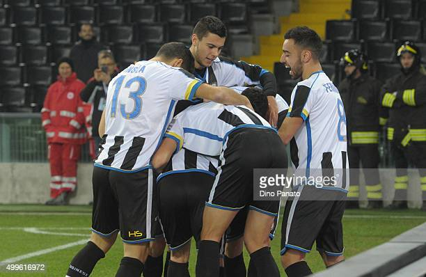 Antonio Di Natale of Udinese is mobbed by team mates after scoring his team's opening goal during the TIM Cup match between Udinese Calcio and...