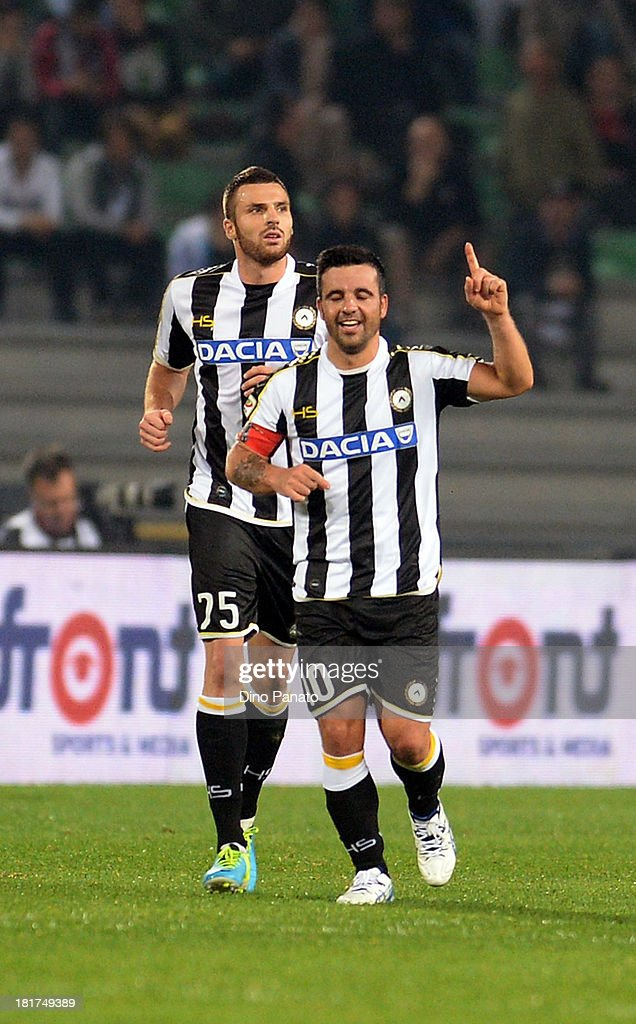 <a gi-track='captionPersonalityLinkClicked' href=/galleries/search?phrase=Antonio+Di+Natale&family=editorial&specificpeople=727545 ng-click='$event.stopPropagation()'>Antonio Di Natale</a> Udinese Calcio celebrates after scoring his opening goal during the Serie A match between Udinese Calcio and Genoa CFC at Stadio Friuli on September 24, 2013 in Udine, Italy.