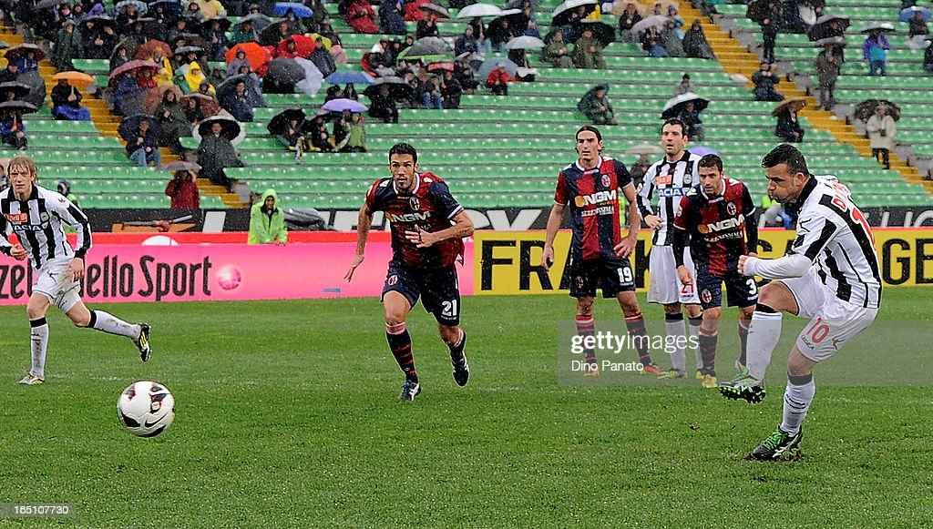 <a gi-track='captionPersonalityLinkClicked' href=/galleries/search?phrase=Antonio+Di+Natale&family=editorial&specificpeople=727545 ng-click='$event.stopPropagation()'>Antonio Di Natale</a> (R) Udinese Calcio missing a penalty spot during the Serie A match between Udinese Calcio and Bologna FC at Stadio Friuli on March 30, 2013 in Udine, Italy.
