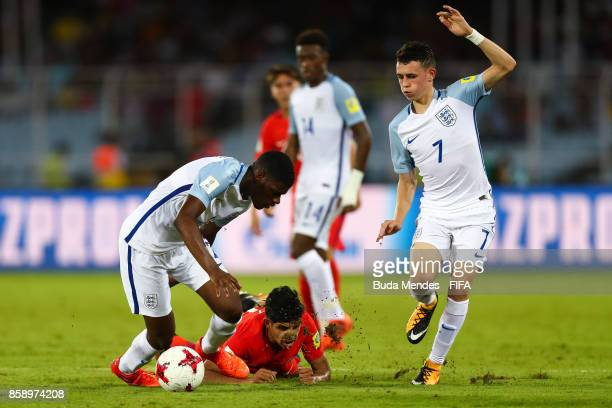 Antonio Diaz of Chile battles for the ball with Philip Foden and Timothy Eyoma of England during the FIFA U17 World Cup India 2017 group F match...