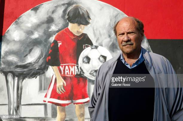 Antonio Enrique Dominguez coach of Lionel Messi between 1999 and 2000 poses for pictures next to a mural of a young Lionel Messi at Newell's Old...
