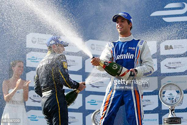 Antonio Felix da Costa of Portugal and Amlin Aguri Formula E Team and Nicolas Prost of France and edams Renault Formula E Team throw champagne at...