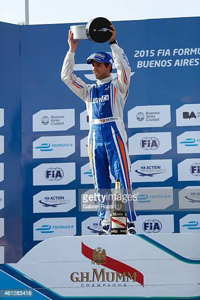 Antonio Felix da Costa of Portugal and Amlin Aguri Formula E Team celebrates at the podium holding the trophy after winning the 2015 FIA Formula E...