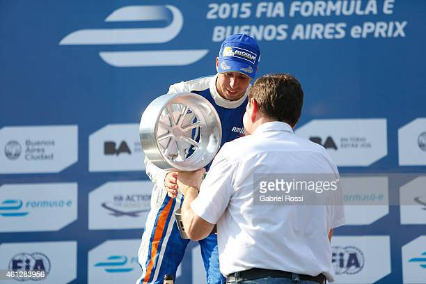 Antonio Felix da Costa of Portugal and Amlin Aguri Formula E Team receives the trophy at the podium after winning the 2015 FIA Formula E Buenos ePrix...
