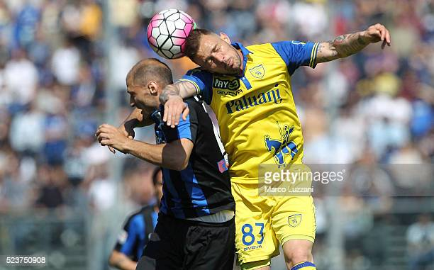 Antonio Floro Flores of AC Chievo Verona competes for the ball with Gabriel Paletta of Atalanta BC during the Serie A match between Atalanta BC and...