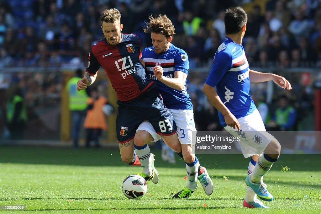 Antonio Floro Flores (L) of Genoa CFC is tackled by Andrea Costa of UC Sampdoria during the Serie A match between Genoa CFC and UC Sampdoria at Stadio Luigi Ferraris on April 14, 2013 in Genova, Italy.