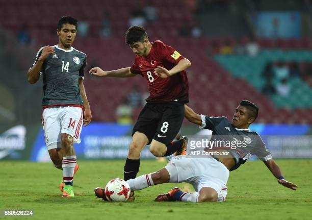 Antonio Galeano of Paraguay and Kerem Kesgin of Turkey vie for the ball during the group stage football match between Turkey and Paraguay in the FIFA...