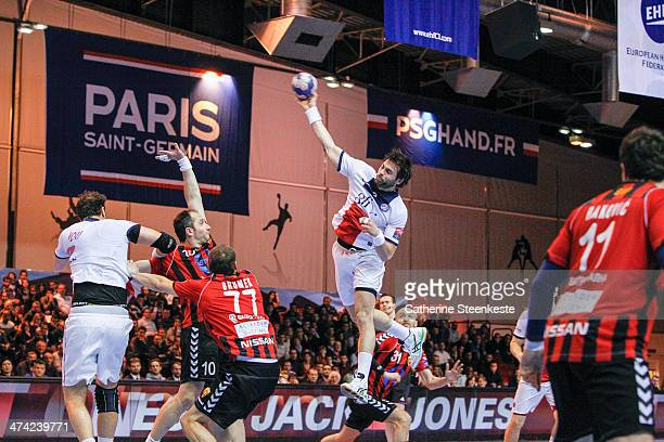 Antonio Garcia of PSG Handball shoots the ball against Alem Toskic and Matjaz Brumen of HC Vardar Skopje during the game between PSG Handball and HC...