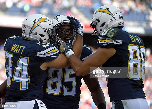 Antonio Gates is congratulated by teammates Derek Watt and Jeremy Butler of the San Diego Chargers after Gates scored his 111th career touchdown...