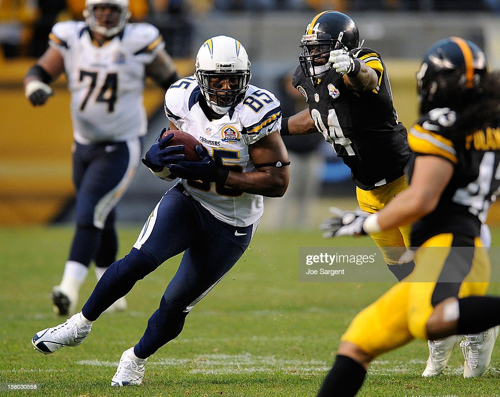 Antonio Gates #85 of the San Diego Chargers avoids a tackle by Lawrence Timmons #94 of the Pittsburgh Steelers on December 9, 2012 at Heinz Field in Pittsburgh, Pennsylvania. San Diego won the game 34-24.