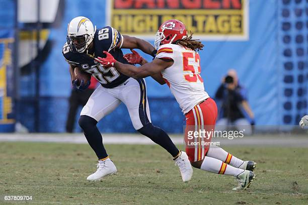 Antonio Gates of the San Diego Chargers carries the ball against Ramik Wilson the Kansas City Chiefs during a NFL game at Qualcomm Stadium on January...