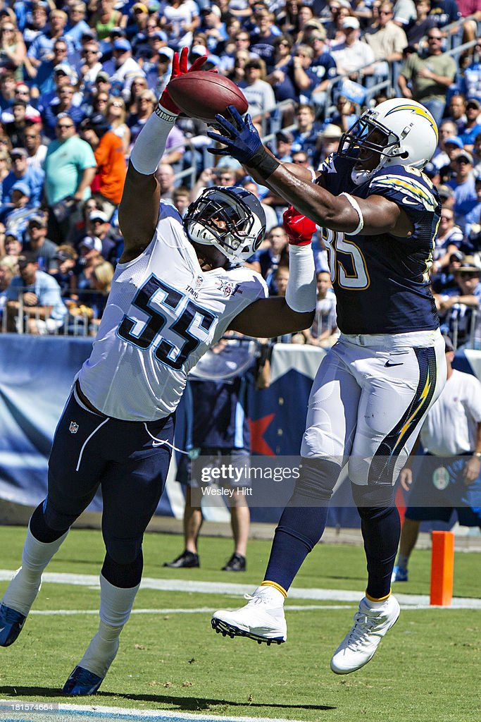 <a gi-track='captionPersonalityLinkClicked' href=/galleries/search?phrase=Antonio+Gates&family=editorial&specificpeople=184491 ng-click='$event.stopPropagation()'>Antonio Gates</a> #85 of the San Diego Chargers catches a touchdown pass in over <a gi-track='captionPersonalityLinkClicked' href=/galleries/search?phrase=Zach+Brown+-+American+Football+Player&family=editorial&specificpeople=6705522 ng-click='$event.stopPropagation()'>Zach Brown</a> #55 of the Tennessee Titans at LP Field on September 22, 2013 in Nashville, Tennessee. The Titans defeated the Chargers 20-17.