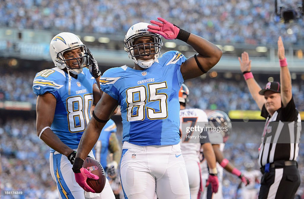 <a gi-track='captionPersonalityLinkClicked' href=/galleries/search?phrase=Antonio+Gates&family=editorial&specificpeople=184491 ng-click='$event.stopPropagation()'>Antonio Gates</a> #85 of the San Diego Chargers celebrates his first quarter touchdown against the Denver Broncos as teammate <a gi-track='captionPersonalityLinkClicked' href=/galleries/search?phrase=Malcom+Floyd&family=editorial&specificpeople=583121 ng-click='$event.stopPropagation()'>Malcom Floyd</a> #80 looks on during the NFL game at Qualcomm Stadium on October 15, 2012 in San Diego, California.