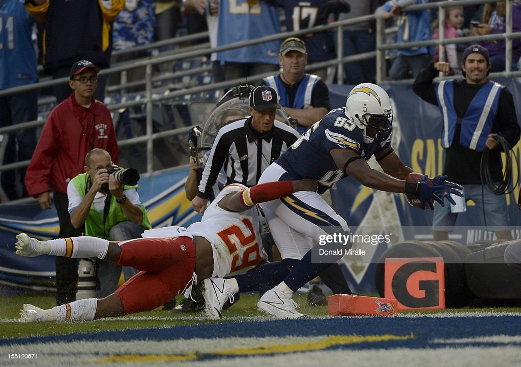 <a gi-track='captionPersonalityLinkClicked' href=/galleries/search?phrase=Antonio+Gates&family=editorial&specificpeople=184491 ng-click='$event.stopPropagation()'>Antonio Gates</a> #85 of the San Diego Chargers scores a touchdown against <a gi-track='captionPersonalityLinkClicked' href=/galleries/search?phrase=Eric+Berry+-+American+Football+Player&family=editorial&specificpeople=4501099 ng-click='$event.stopPropagation()'>Eric Berry</a> # 29 of the Kansas City Chiefs on November 1, 2012 at Qualcomm Stadium in San Diego, California.