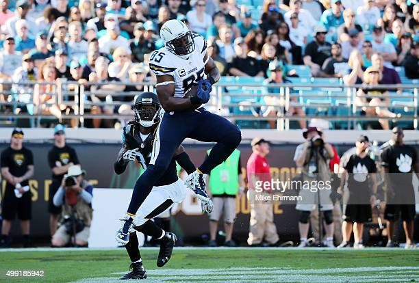 Antonio Gates of the San Diego Chargers scores a touchdown in the second quarter as Davon House of the Jacksonville Jaguars defends at EverBank Field...
