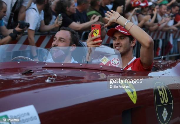 Antonio Giovinazzi of Italy and Ferrari waves to the crowd on the drivers parade at Castello Sforzesco on August 31 2017 in Milan Italy