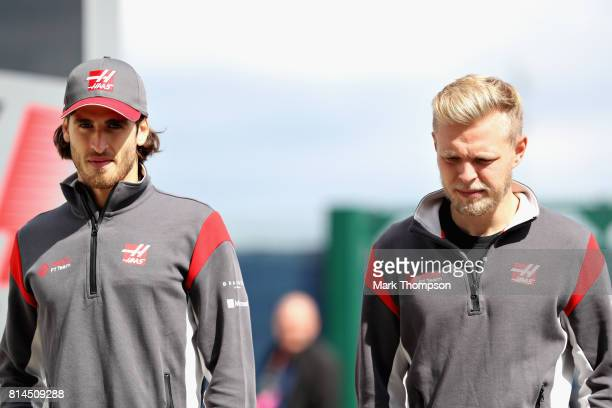 Antonio Giovinazzi of Italy and Haas F1 and Kevin Magnussen of Denmark and Haas F1 walk in the Paddock during practice for the Formula One Grand Prix...