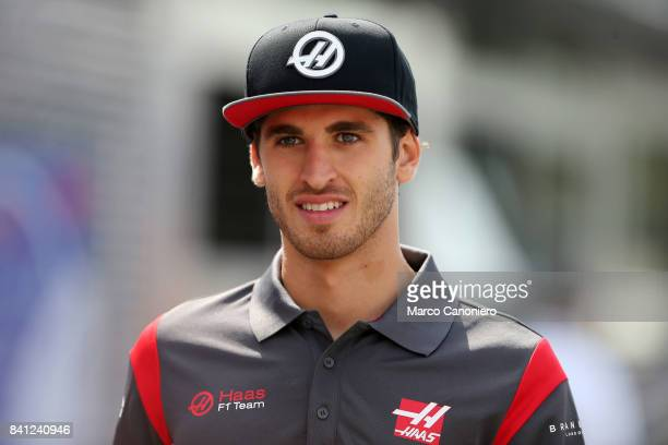 Antonio Giovinazzi of Italy and Haas F1 walk in the Paddock during during the Italian Formula One Grand Prix