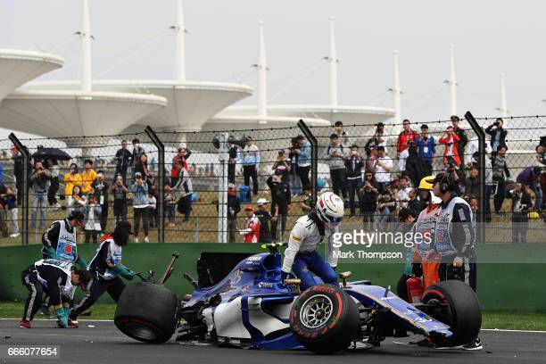 Antonio Giovinazzi of Italy and Sauber F1 climbs out of his car after crashing during qualifying for the Formula One Grand Prix of China at Shanghai...