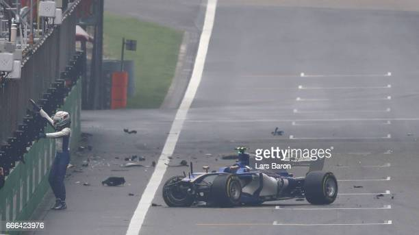 Antonio Giovinazzi of Italy and Sauber F1 leaves the track aftr crashing his Sauber into the wall during the Formula One Grand Prix of China at...