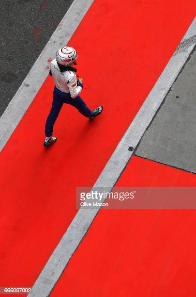 Antonio Giovinazzi of Italy and Sauber F1 walks in the Pitlane after crashing during qualifying for the Formula One Grand Prix of China at Shanghai...