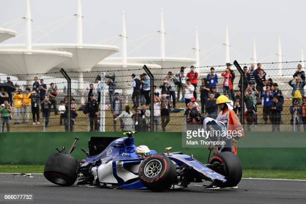 Antonio Giovinazzi of Italy driving the Sauber F1 Team Sauber C36 Ferrari sits in his car on track after crashing into a track barrier during...