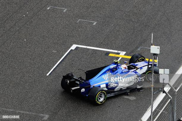 Antonio Giovinazzi of Italy driving the Sauber F1 Team Sauber C36 Ferrari climbs out of his after crashing during the Formula One Grand Prix of China...