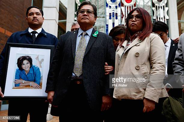 Antonio Gotingco the husband of Blessie Gotingco stands alongside family outside the Auckland High Court on May 22 2015 in Auckland New Zealand A...