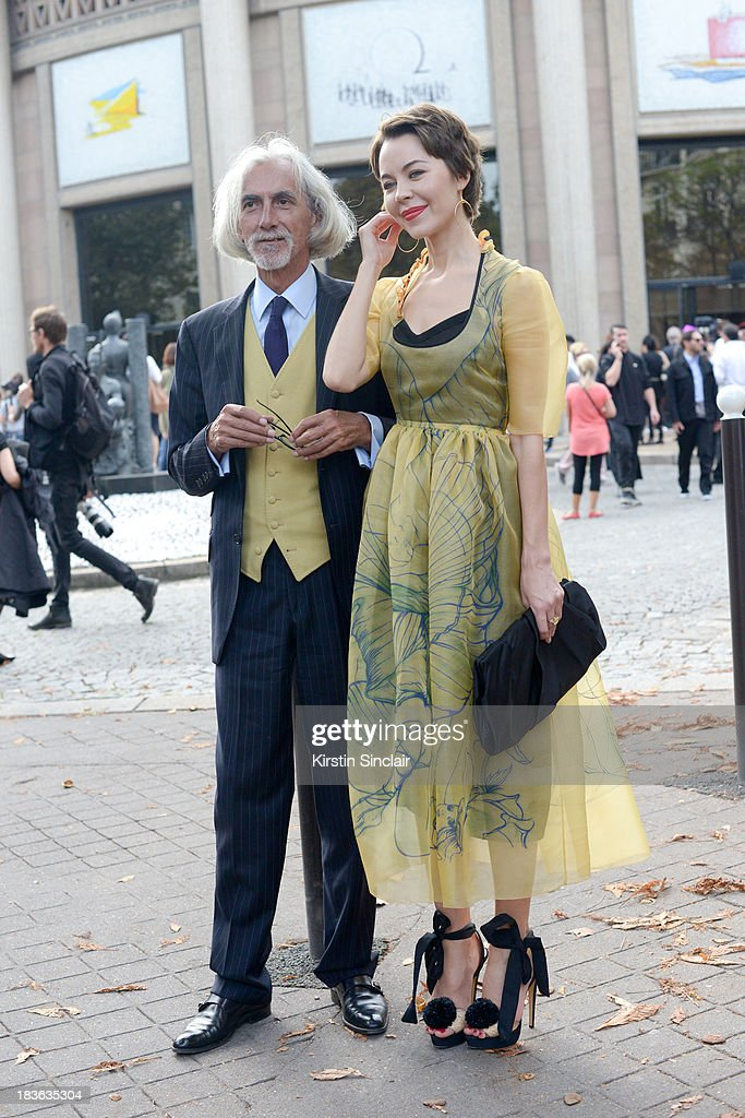 Antonio Joaquim and Fashion designer and photographer Ulyanna Sergeenko wearing her own design dress with Prada shoes and bag on day 9 of Paris Fashion Week Spring/Summer 2014, Paris October 02, 2013 in Paris, France.