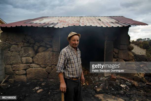 Antonio Lopez poses for a photo next to his cattle stable where his four cows died during a wildfire in the village of Vila Nova near Vouzela on...