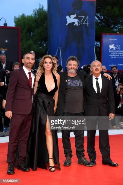 Antonio Manetti Claudia Gerini Marco Manetti and Carlo Buccirosso walk the red carpet ahead of the 'Ammore E Malavita' screening during the 74th...