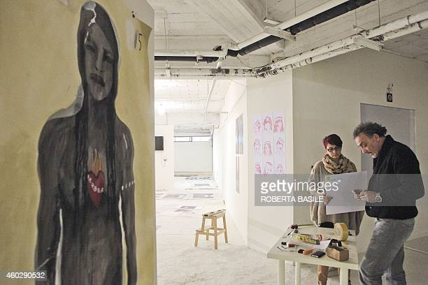 Antonio Manfredi CAM art director and his assistant Graziella Geraci take part to the preparation of the exhibition 'I am Woman' at CAM Casoria on...