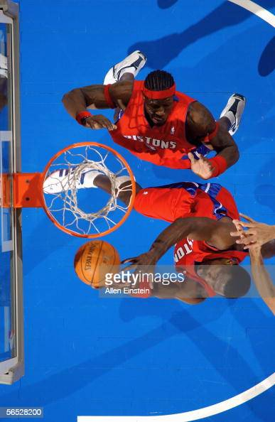Antonio McDyess and Ben Wallace of the Detroit Pistons go after a rebound during the game against the San Antonio Spurs on December 25 2005 at the...