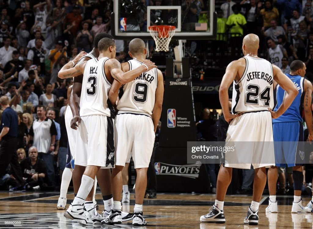 Antonio McDyess #34, George Hill, Tony Parker #9 and Richard Jefferson #24 of the San Antonio Spurs huddle on the court in Game Four of the Western Conference Quarterfinals against the Dallas Mavericks during the 2010 NBA Playoffs at AT&T Center on April 25, 2010 in San Antonio, Texas. The Spurs won 92-89.
