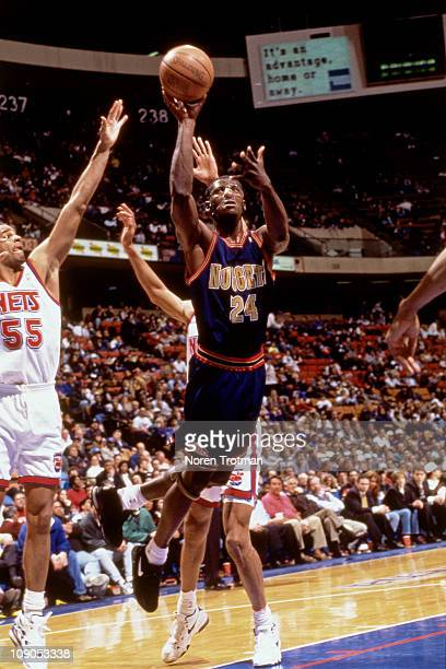Antonio McDyess of the Denver Nuggets shoots against Jayson Williams of the New Jersey Nets in a game on March 21 1996 at The Continental Airlines...