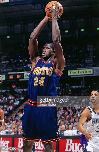 Antonio McDyess of the Denver Nuggets shoots against the Sacramento Kings circa 1997 at Arco Arena in Sacramento California NOTE TO USER User...