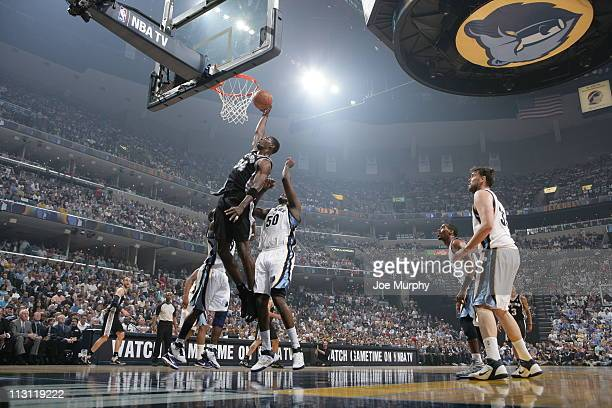Antonio McDyess of the San Antonio Spurs dunks against Zach Randolph of the Memphis Grizzlies in Game Three of the Western Conference Quarterfinals...