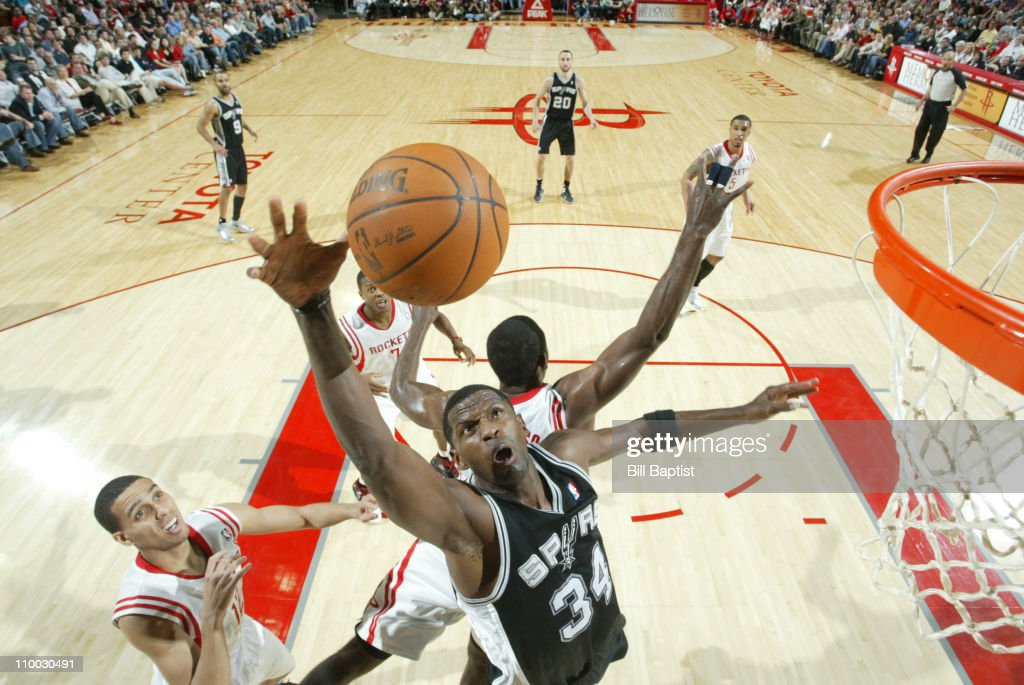 Antonio McDyess #34 of the San Antonio Spurs shoots the ball over Kevin Martin #12 of the Houston Rockets on March 12, 2011 at the Toyota Center in Houston, Texas.