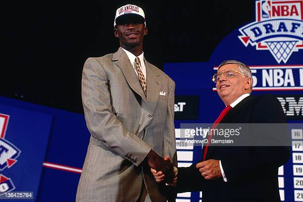 Antonio McDyess shakes hands with NBA Commissioner David Stern after being selected number two overall by the Denver Nuggets during the 1995 NBA...