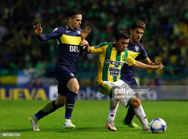 Antonio Medina of Aldosivi fights for the ball with Fernando Gago and Lisandro Magallán of Boca Juniors during a match between Aldosivi and Boca...
