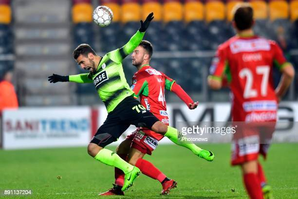 Antonio Milic defender of KV Oostende battles for the ball with Orlando Sa forward of Standard Liege during the Belgian Croky Cup match between KV...