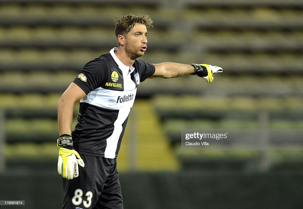 <a gi-track='captionPersonalityLinkClicked' href=/galleries/search?phrase=Antonio+Mirante&family=editorial&specificpeople=2114402 ng-click='$event.stopPropagation()'>Antonio Mirante</a> of Parma FC reacts during the pre-season friendly match between Parma FC and Olympique Marseille at Stadio Ennio Tardini on July 31, 2013 in Parma, Italy.