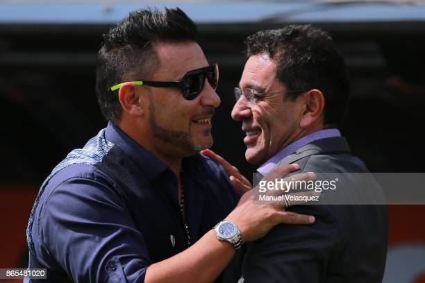 Antonio Mohamed coach of Monterrey greets David Patiño coach of Pumas during the 14th round match between Pumas UNAM and Monterrey as part of the...