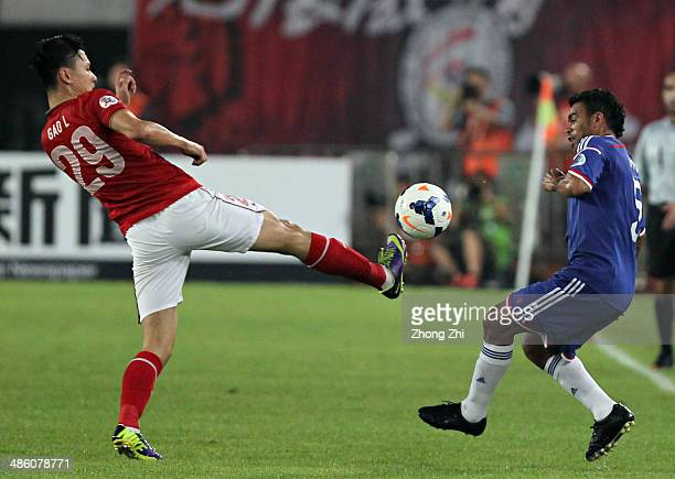 Antonio Monteiro Dutra of Yokohama F Marinos competes for the ball with Gao Lin of Guangzhou Evergrande during the AFC Asian Champions League match...