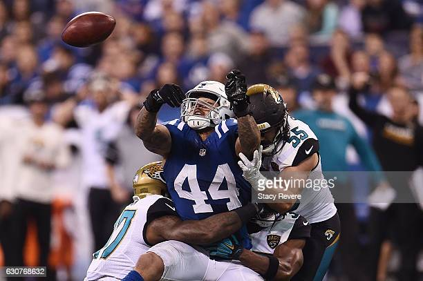 Antonio Morrison of the Indianapolis Colts tries to pass the ball after a blocked punt during the second half of a game against the Jacksonville...
