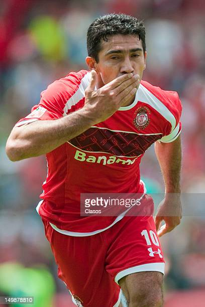 Antonio Naelson of Toluca celebrates a goal during a match between Toluca and Leon as part of the Torneo Apertura 2012 at Nemesio Diez Stadium on...