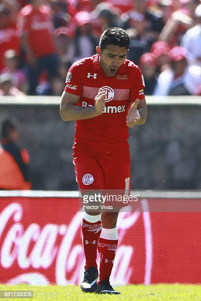 Antonio Naelson of Toluca celebrates after Pablo Barrientos of Toluca scored the third goal of his team during the 1st round match between Toluca and...
